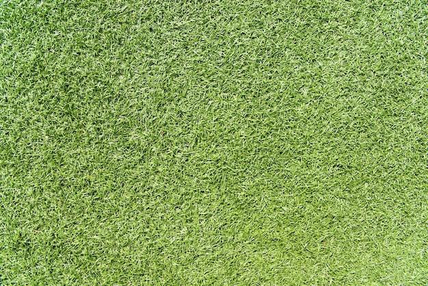 草の質感。緑色の背景。