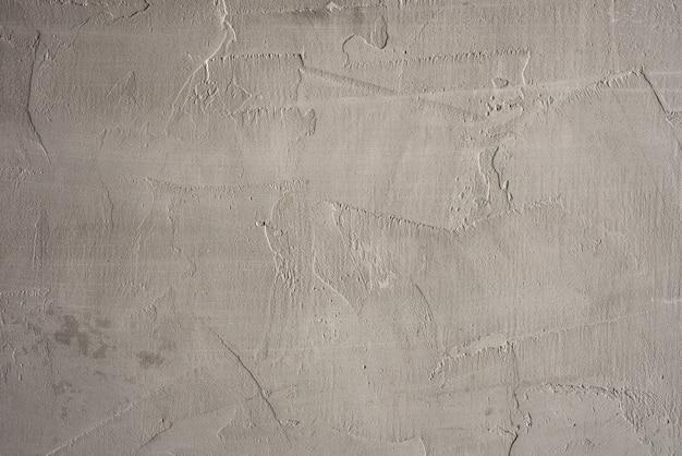 주걱으로 만든 회색 시멘트 벽의 질감