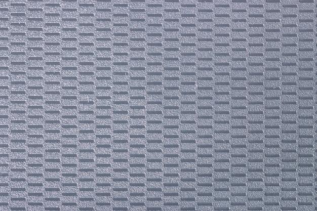 長方形のインサートを備えたグレーのエンボスプラスチックのテクスチャ