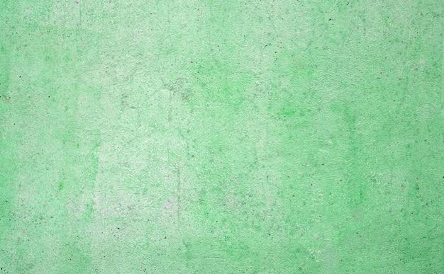 背景の緑のコンクリート壁のテクスチャ。