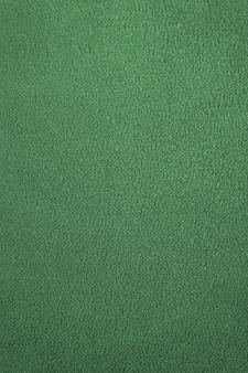 緑の不均一なフリース綿生地の質感