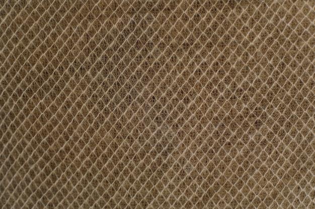 Текстура вязаной шерстяной ткани фона