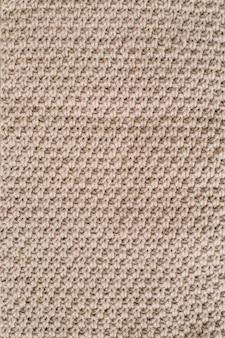 Текстура трикотажной шерстяной ткани для обоев и абстрактный фон