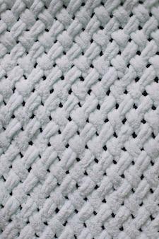 벽지 및 추상적 인 배경을위한 니트 모직물의 질감