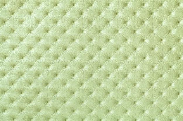 キャピトンパターン、マクロと薄緑色の革の背景のテクスチャ