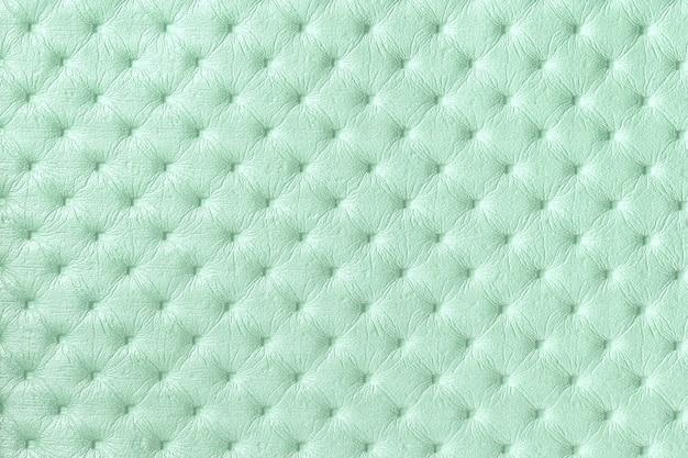 キャピトンパターンのライトグリーンレザー表面の質感