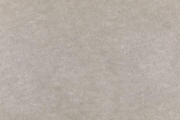 ライトグレーのクラフト紙の背景のテクスチャ。