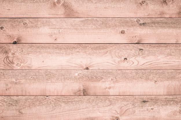 가벼운 나무 보드의 질감입니다. 부드러운 분홍색 목재 표면. 자연 벽지 패턴. 흰색 나무 배경입니다. 소박한 목재 바닥, 빈티지 널빤지. 인테리어 요소.