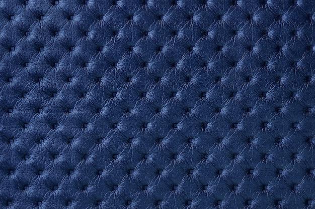 キャピトンパターンとネイビーブルーの革生地の背景のテクスチャ