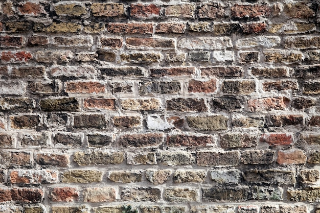 古いダークブラウンのブロック、赤レンガの壁のテクスチャ。