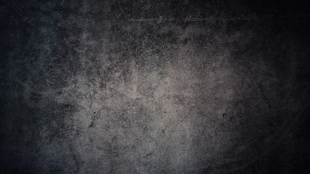 어두운 회색 배경에 대 한 오래 된 회색 콘크리트 벽의 질감