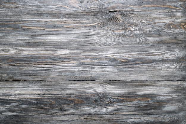素朴なまたはみすぼらしいスタイルの古い灰色の木製の板テーブルのテクスチャ。