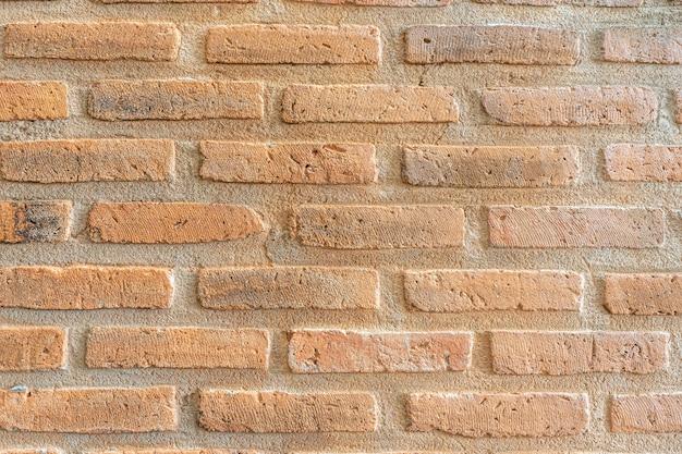 古いオレンジ色のレンガの壁の大きな背景のテクスチャ。