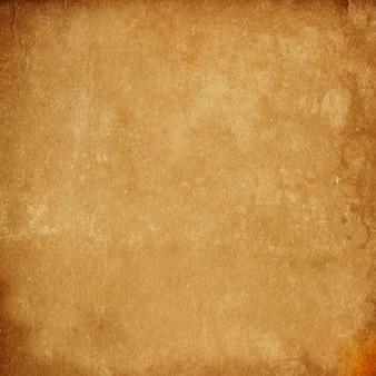 古いヴィンテージ茶色の紙の背景のテクスチャ