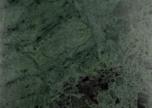 古いヴィンテージの緑の大理石の壁紙のクローズアップのテクスチャ