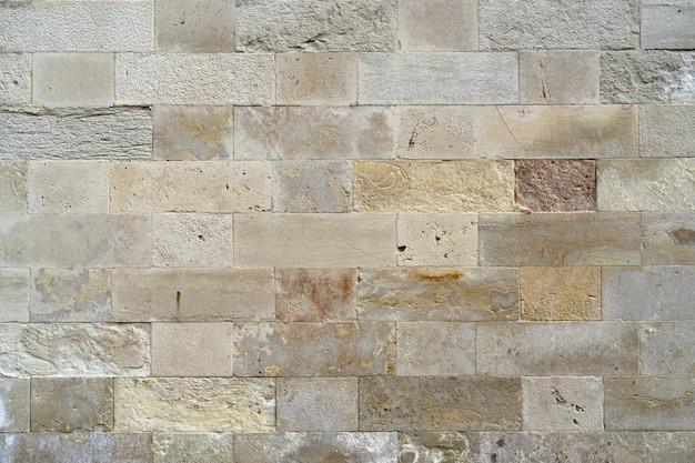 石のブロックの背景で作られた古い壁のテクスチャ