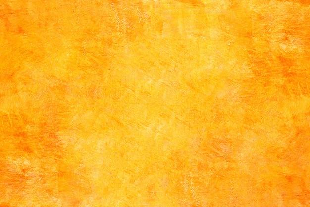 オレンジ色のコンクリート壁の背景のテクスチャ。