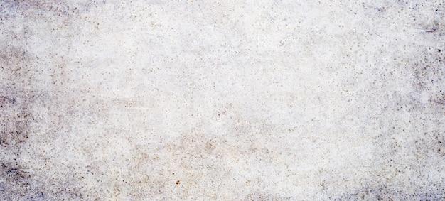 Текстура оранжевого фона бетонной стены.