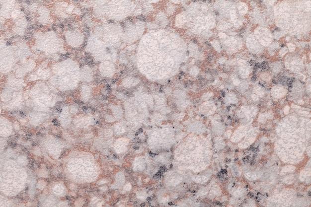 斑点模様のピンクと白の大理石のテクスチャ