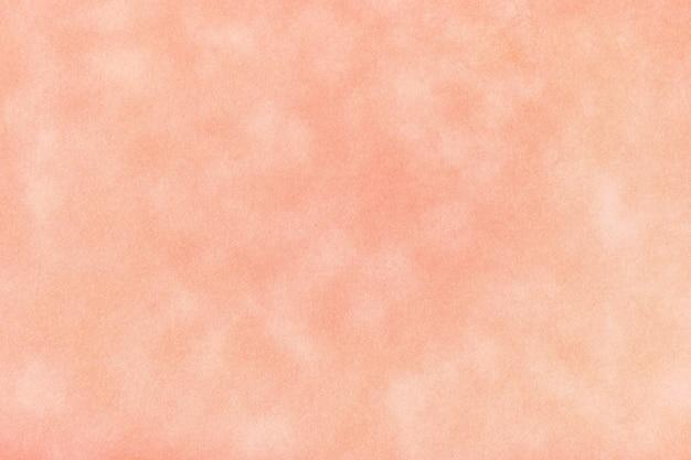 ピンクの古い紙の質感、しわくちゃの背景