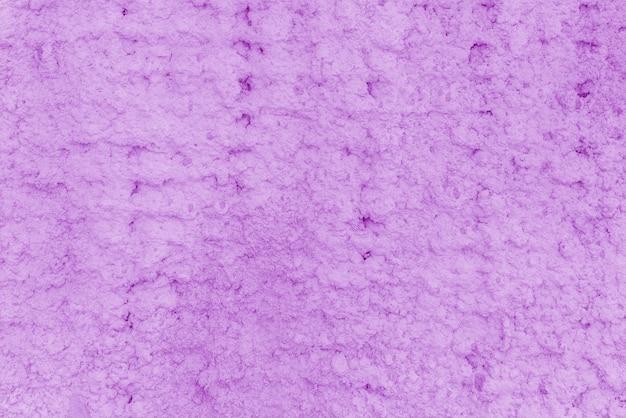 ピンクの漆喰の質感。建物の粗い壁。