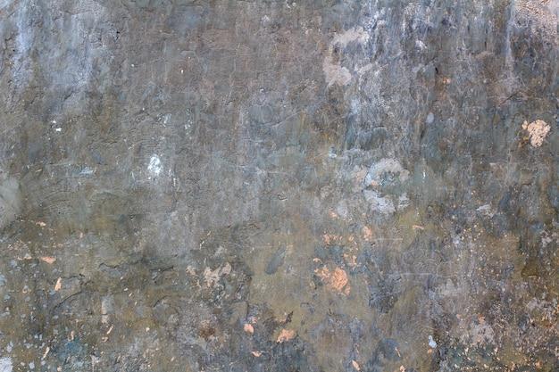 Текстура оштукатуренной кирпичной стены с пятнами краски. абстрактный фон стены