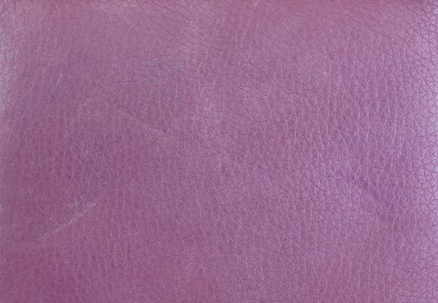 Текстура фиолетового кожаного кошелька.