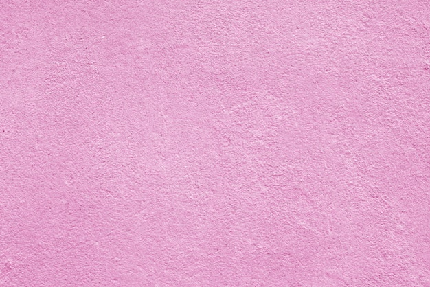 ざらざらしたピンクの漆喰の質感。建築の抽象的な背景。