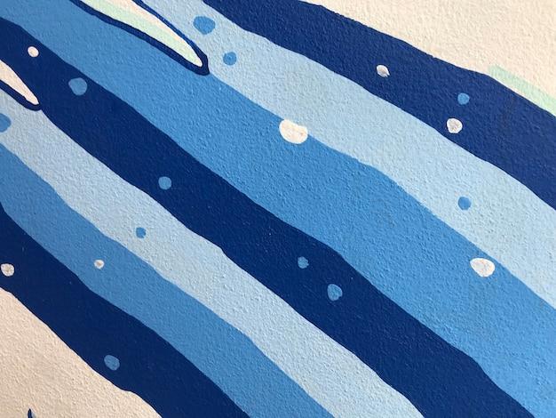 거친 흰색과 파란색 석고의 질감입니다. 건축 추상적인 배경입니다.