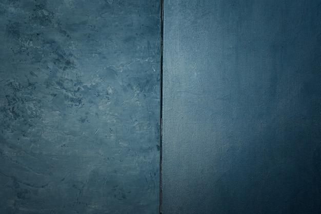 石や岩のラフとテクスチャキャンバスブラックカラーのテクスチャ。ヴィンテージの苦しめられたグランジとダークグレーの背景を持つエレガント。