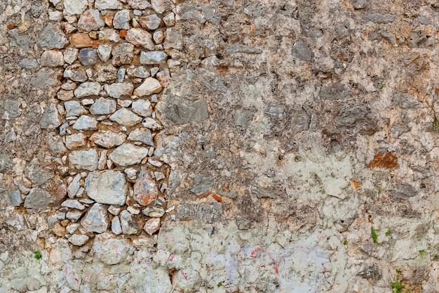 돌담, 오래된 돌의 질감. 오래 된 돌담의 배경