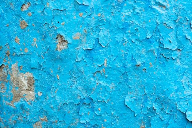 ペイントと錆の多くの層とヴィンテージのさびた青と灰色の鉄の壁の背景のテクスチャ