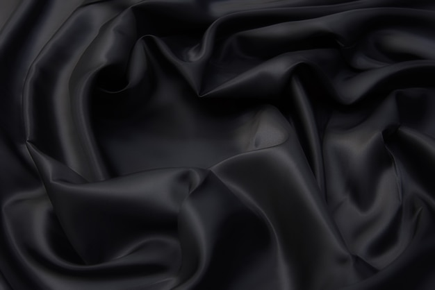 Текстура вискозной ткани серого цвета. фон, узор.