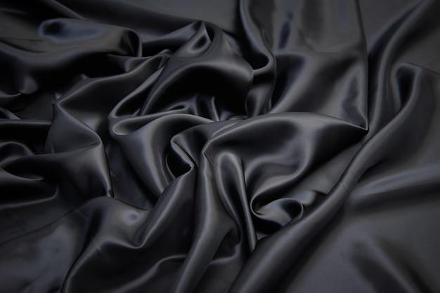 Текстура вискозной ткани в сером цвете.
