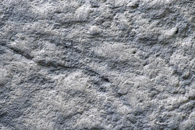 Текстура выдержанного серого цвета с белой каменной предпосылкой. крупный план