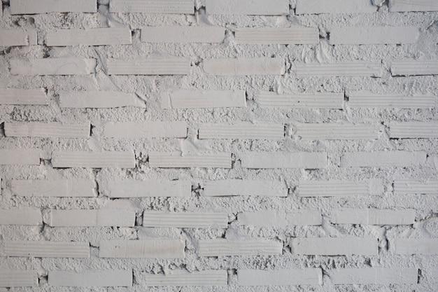白いレンガの背景のテクスチャ