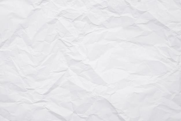Текстура бумаги скомканной белизной для предпосылки.
