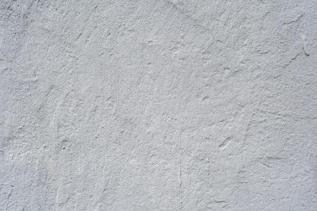 白い塗られたレリーフ壁のテクスチャ
