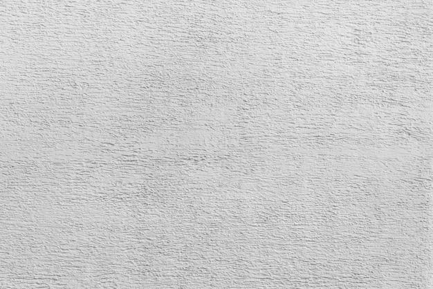 白い漆喰の質感。モダンなロフトのインテリア。抽象的なラフな背景。古い家のファサード。