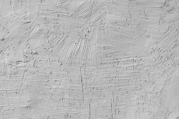 오래 된 집의 벽에 흰색 석고의 질감. 건축 설계.