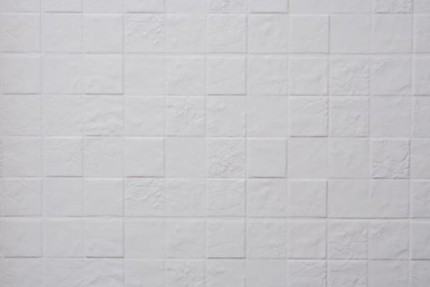 キッチンの白い四角いタイルの質感。幾何学、スタイル、デザイン。