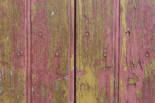 木製の板のテクスチャ。ひびの入った塗料。
