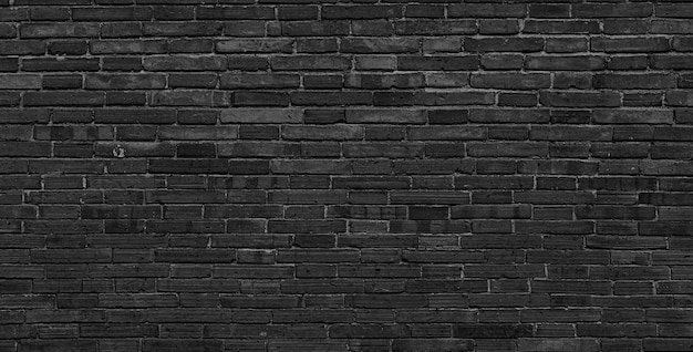 Texture of old black brick wall large background.