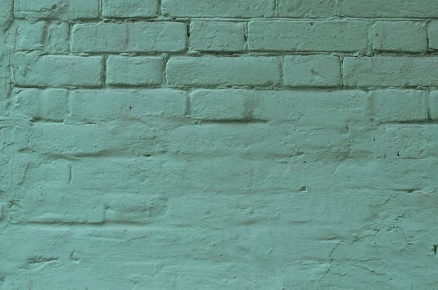 Texture of old blue brick wall surface with cement and concrete seams