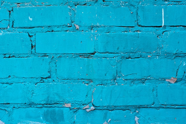 Texture of old blue brick wall surface with cement seams