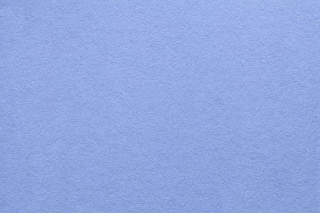 Texture of old blue paper background, closeup