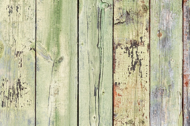 The texture of the old blue wooden fence. space for text. background.
