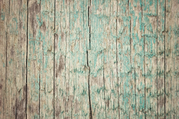 The texture of the old board with peeling blue paint