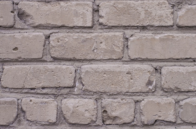 Texture of old brick in gray shade of color