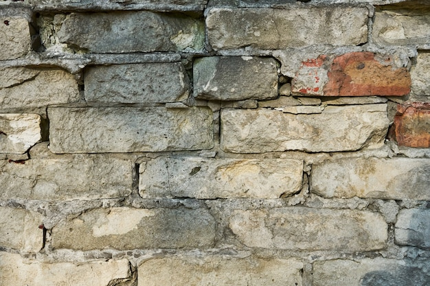 Texture of an old brick wall with cracks. wall for web page fill or graphic design. pattern. map for 3d texture.
